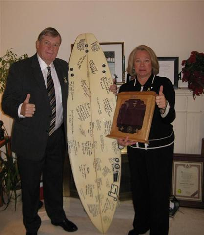 The Nuttalls with the surfboard gift.